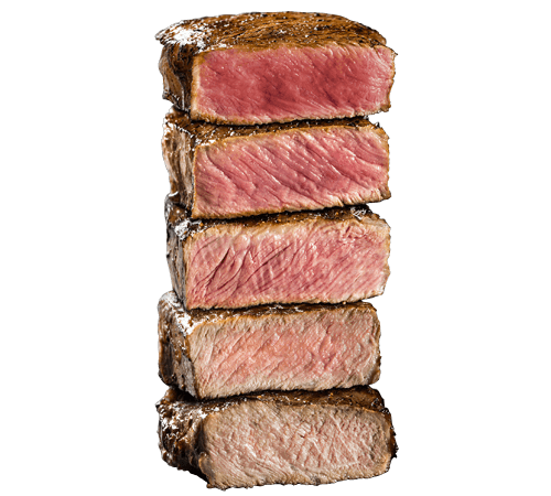 Stack of beef steaks cut to show the different degrees of doneness