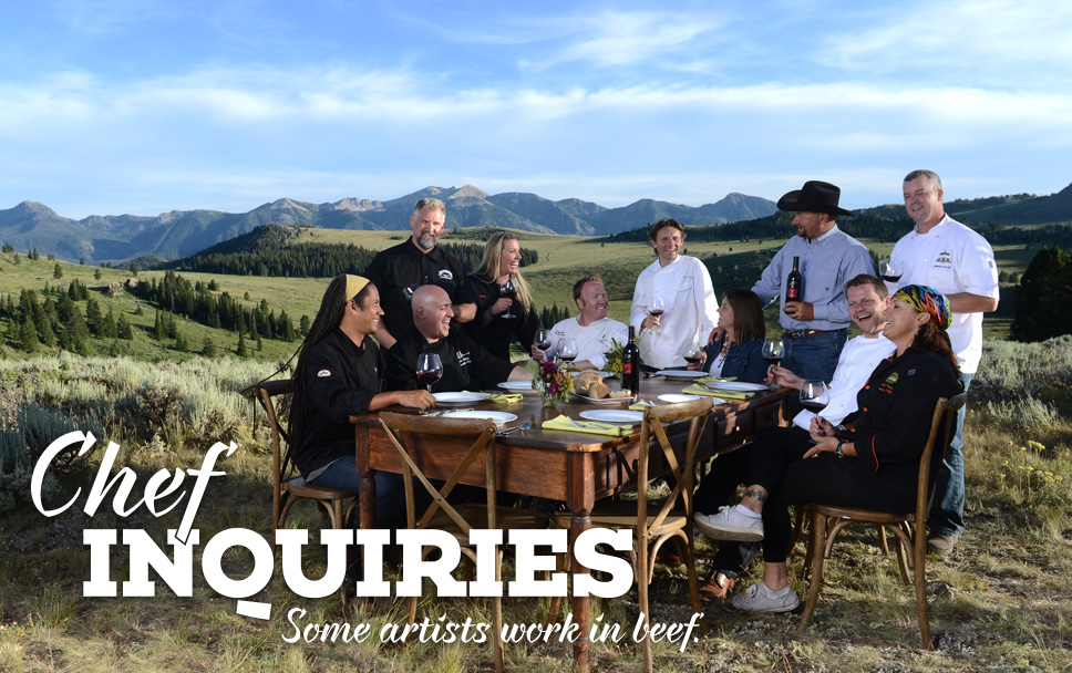 Chefs at a table in the mountains, sharing their art