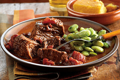 Smoky Chipotle Pot Roast with Cornbread recipe provided by the Certified Angus Beef® brand.