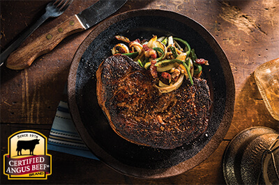 Cast Iron Charred Ribeye with Bacon, Whiskey Onions and Hot Peppers recipe provided by the Certified Angus Beef® brand.