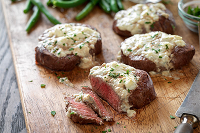 Tenderloin Steaks with Blue Cheese Topping recipe provided by the Certified Angus Beef® brand.