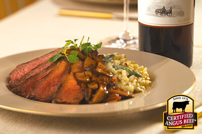 Steak with Asparagus Risotto and Tomato Red Wine Sauce recipe provided by the Certified Angus Beef® brand.