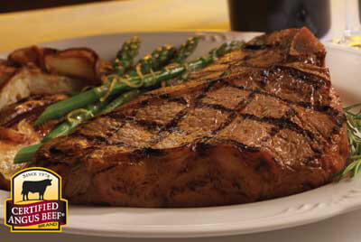 Porterhouse for Two with Lemon Potatoes & Asparagus recipe provided by the Certified Angus Beef® brand.