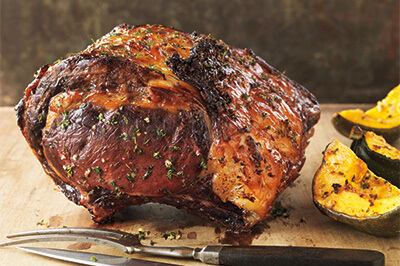 Maple-Glazed Rib Roast With Roasted Acorn Squash recipe provided by the Certified Angus Beef® brand.