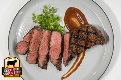 Evander's Grilled Strip Steaks with Real Deal Steak Sauce recipe provided by the Certified Angus Beef® brand.